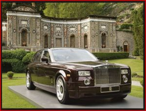 photo of rolls royce and a castle